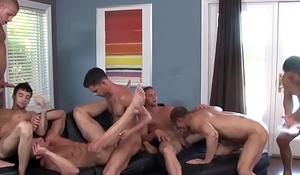Muscular athletes enjoying naughty orgy