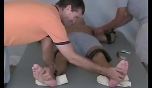 Restrained stud has feet serviced by rough ticklers