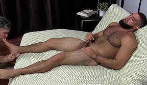 Muscular Ricky Larkin wanking off while toes are sucked