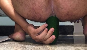 Riding a bulky cucumber in my bore pussy