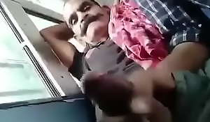 Playing with village old man's cock in bus