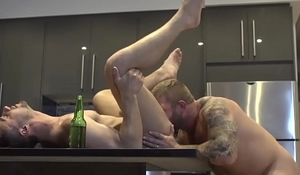 Inked muscle bear rims ass during kitchen sex